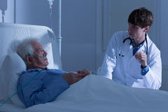 Elder patient and doctor Royalty Free Stock Image