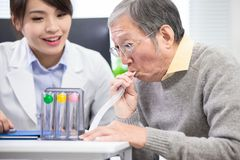 Elder Patient Has Triflow Training Royalty Free Stock Image