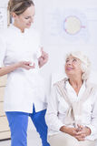 Elder patient and nurse Stock Image