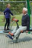 Elder people in outdoor gym. Image of elder people spending leisure time in outdoor gym Stock Image