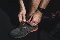 Elder person putting shoes on Stock Photography