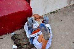 An elder relaxes in Varanasi, India. An local elder relaxes in Varanasi, India royalty free stock images