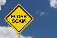 Elder Scam Warning Sign. Yellow warning sign with words Elder Scam with a sky background Stock Images