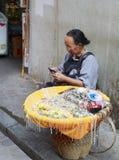 Elder sell silver bracelet in marketplace Stock Photo