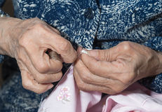 Elder sewing Stock Image