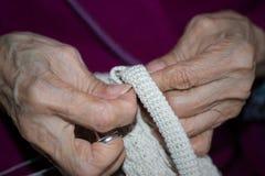Elder sewing Royalty Free Stock Image