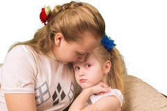Elder sister consoles the younger  on Royalty Free Stock Images