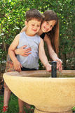 Elder sister embraces the younger brother Royalty Free Stock Photography