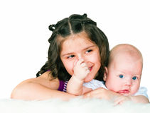 Elder sister and little brother stock photos