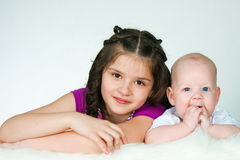 Elder sister and little brother Stock Images