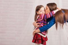 Elder sister and little girl Stock Image