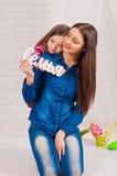 Elder sister and little girl Royalty Free Stock Images