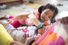 Free Elder Sister Lull Her Younger Brother To Sleep Stock Images - 122131304