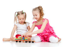 Elder sister playing with child stock photo