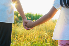 Elder sister and younger sister holds the hand royalty free stock photo
