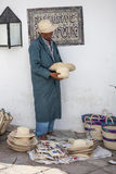 Elder street vendor selling handmade souvenirs Royalty Free Stock Photos