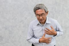 Elder suffer from Chest pain from Heart Attack. Asian Elder suffer from Chest pain from Heart Attack or Stroke with space for text stock image