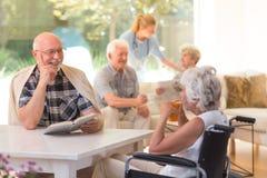 Elder talking to woman Royalty Free Stock Images