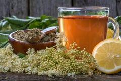 Elder  tea. Domestic healthy elder  tea on a rustic wooden table Royalty Free Stock Images