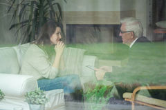 Elder therapist consulting patient Stock Images