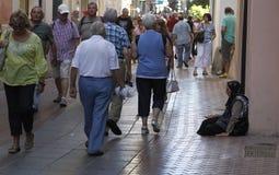 Elder woman begging Royalty Free Stock Image