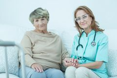 Elder woman and caring doctor. Portrait of elder women and caring doctor Royalty Free Stock Photo