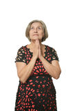 Elder woman. Close-up portrait of an elder woman isolated in studio Royalty Free Stock Images