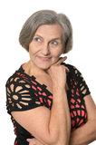 Elder woman. Close-up portrait of an elder woman isolated in studio Royalty Free Stock Photos
