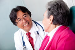 Elder woman at the doctor Royalty Free Stock Photography
