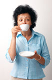 Elder Woman Drinking Coffee. Stock Photo