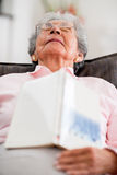 Elder woman falling asleep Royalty Free Stock Image