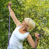 Elder woman with fitness band in the nature Royalty Free Stock Image