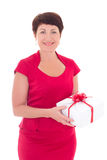 Elder woman with gift box isolated on white Royalty Free Stock Photo