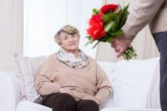 Elder woman having birthday Stock Photo