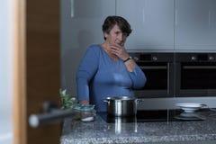 Elder woman in the kitchen stock photo