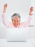 Elder woman with a laptop Royalty Free Stock Photo