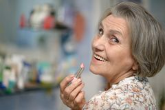 Elder woman with lipstick royalty free stock image