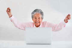 Elder woman online success Stock Image