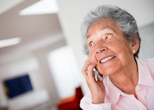Elder woman on the phone Royalty Free Stock Images