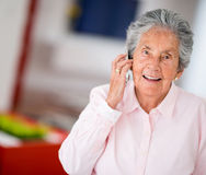 Elder woman on the phone Stock Photos