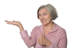 Elder woman pointing at copy space Royalty Free Stock Images