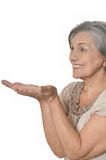 Elder woman pointing at copy space Royalty Free Stock Photo