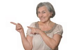 Elder woman pointing at copy space Stock Image