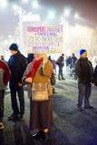 Elder woman with protest message, Bucharest, Romania Stock Image