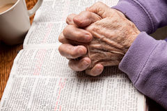 Elder Woman's Hands on Bible Stock Photography