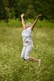 Elder woman smiling and jumping Stock Photography