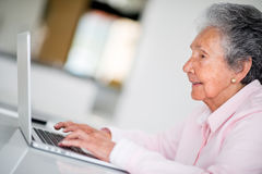 Elder woman using a computer Stock Photography