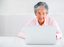 Elder woman using a laptop Stock Image