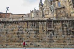 Elder woman walking by Plasencia Old Town, Spain Royalty Free Stock Image