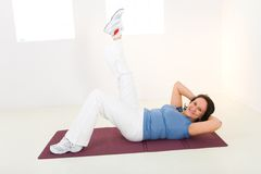 Elder Woman Working Out On Mat Stock Images
